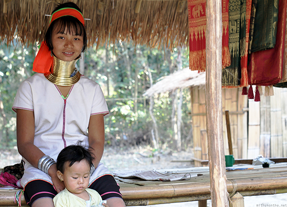 A Karen girl with her child in Chiang Mai outskirts