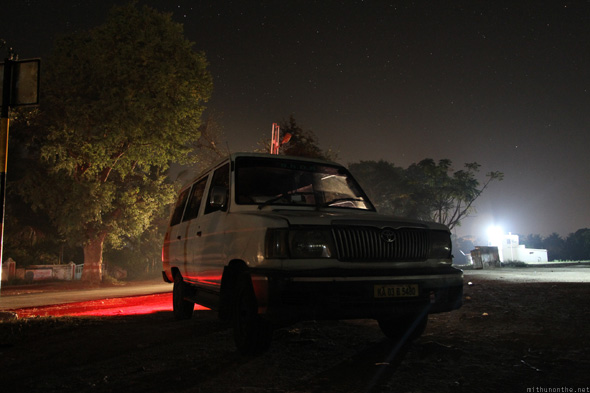 Toyota Qualis taxi at night