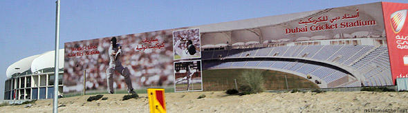 Driving past the Dubai Cricket stadium sign on Emirates road