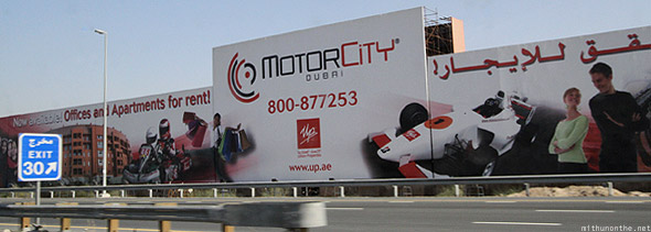Dubai motor city board sign