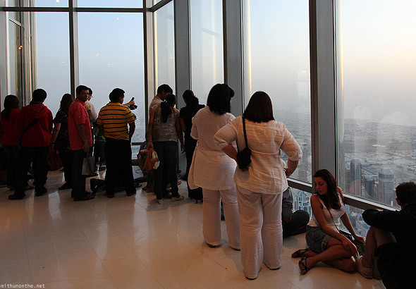 At The Top Burj Khalifa tourists watching sunset