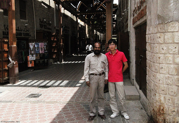 Bur Dubai souk Chinese man with father