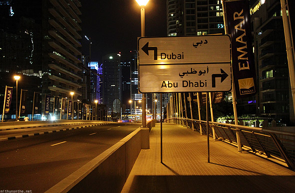 Dubai Marina bridge Dubai Abu Dhabi sign