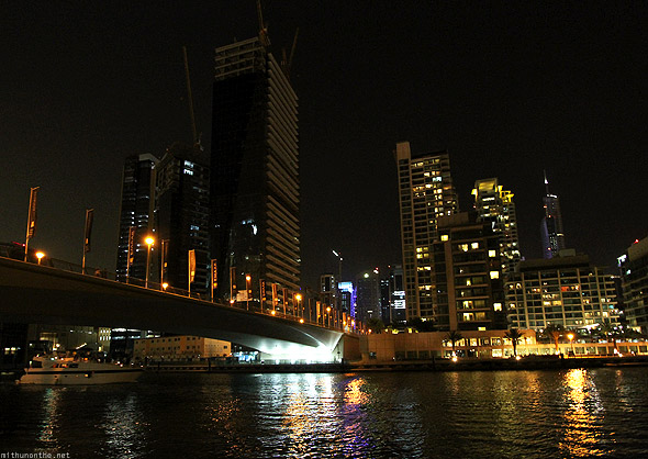 Dubai Marina at night bridge yacht rental