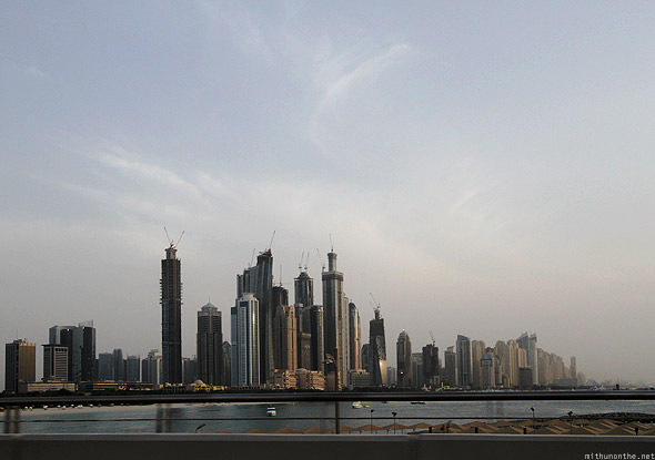 Dubai Marina construction buildings from sea