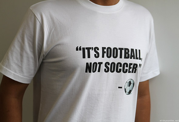 Loiyumba wearing Its Football Not Soccer t-shirt white