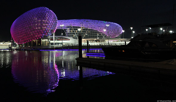 Yas Marina hotel at night reflection yacht