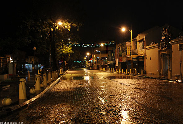Penang night cobble stone temple junction road rain Georgetown