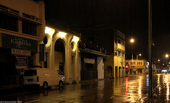 Penang street lamps glow rainy night
