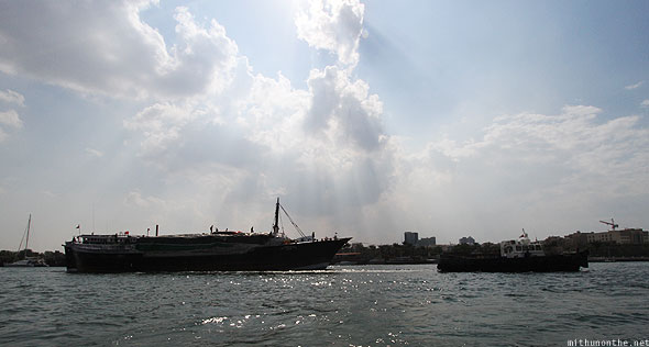 Dubai creek trade boat afternoon sky