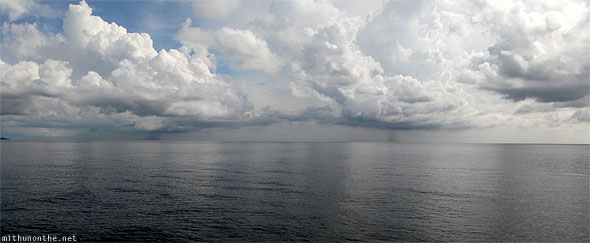 Malacca Strait rain showers clouds panorama