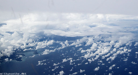 Indonesia shoreline clouds from Malaysia aerial view