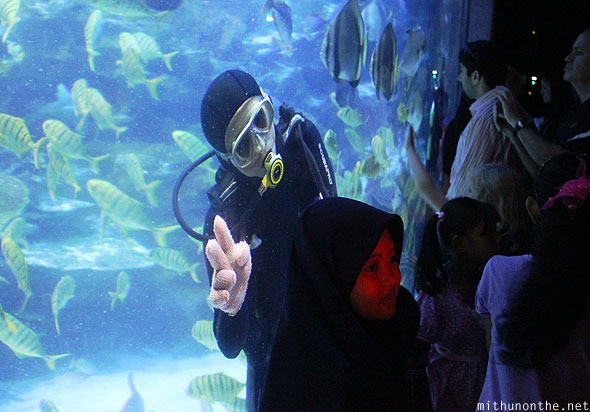 KLCC Aquaria diver playing around with tourist