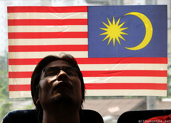Loiyumba sleeping in train Malaysian flag glass
