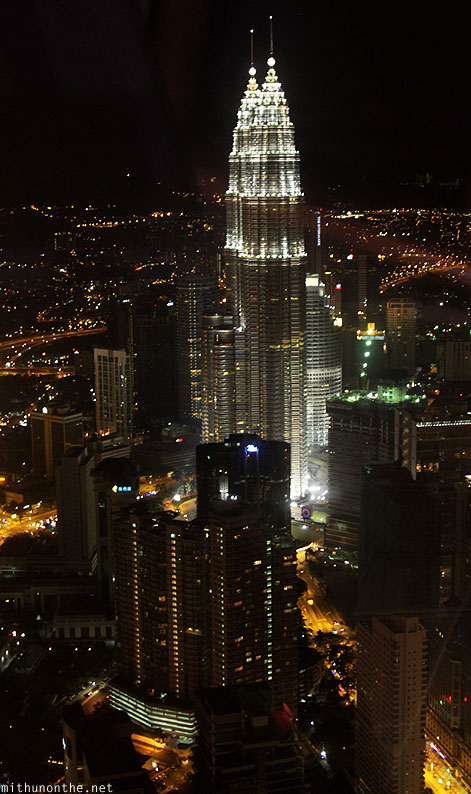 Menara KL tower observation deck Petronas Towers at night