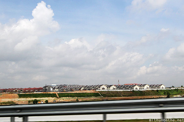 Row houses villas Kuala Lumpur outskirts airport highway