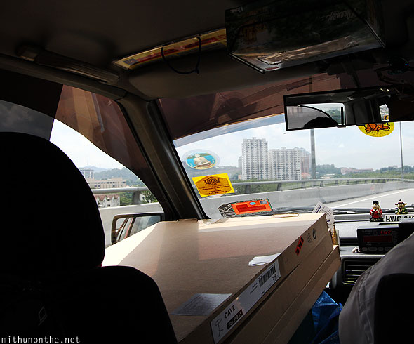 Taxi driving to LCCT airport with luggage