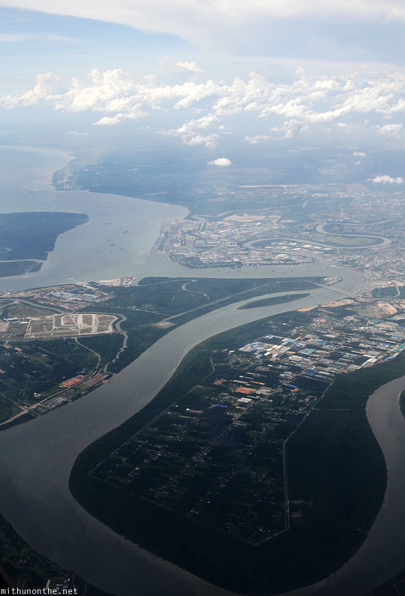 Telok Gong Malaysia river into Malacca Strait from sky plane