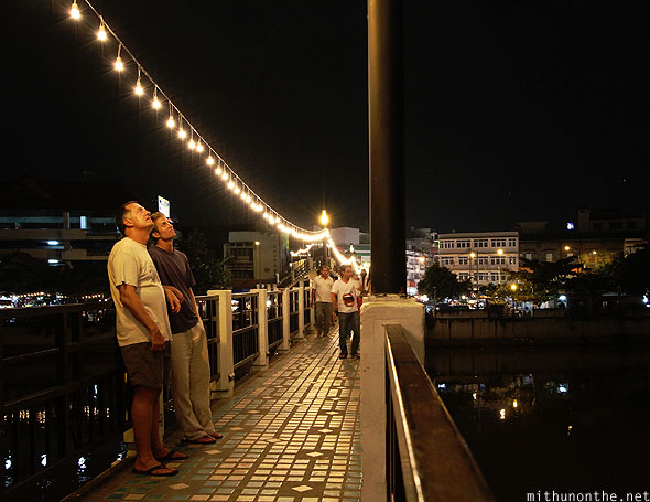 Chiang Mai Loy Krathong lit up bridge tourists