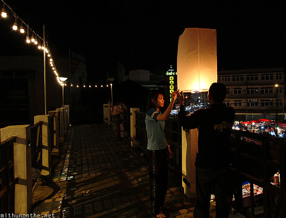 Chiang Mai Loy Krathong ping bridge Thai couple lantern
