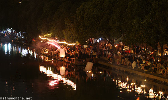 Ping river crowds Thai firecrackers Chiang Mai