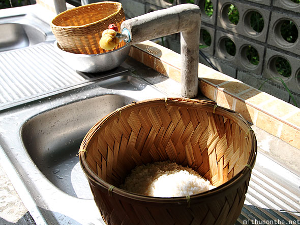 Thai farm cooking class rice in washing basket