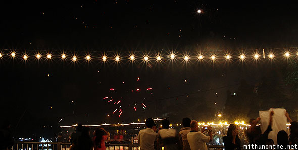 Chiang Mai Loy Krathong lightbulbs bridge revelers