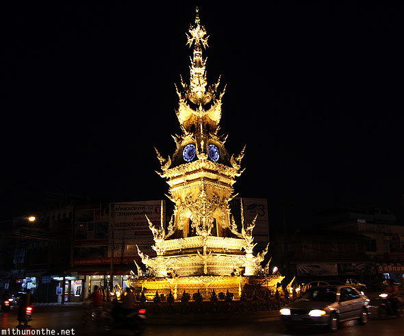 Golden clock tower at night Chiang Rai Thailand