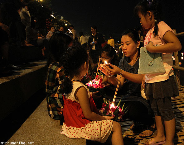 Ping river steps Loy Krathong Thai family
