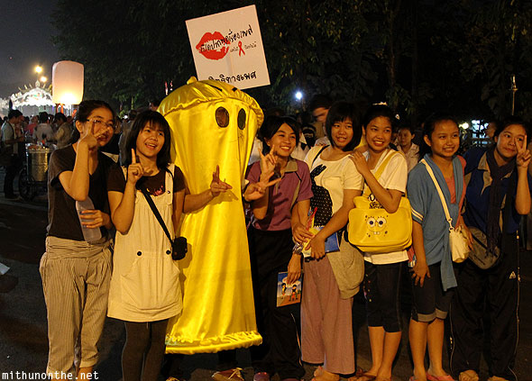 Thai girls posing condom AIDS awareness Chiang Mai