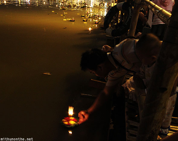 Thai local releasing Krathong in water Chiang Mai