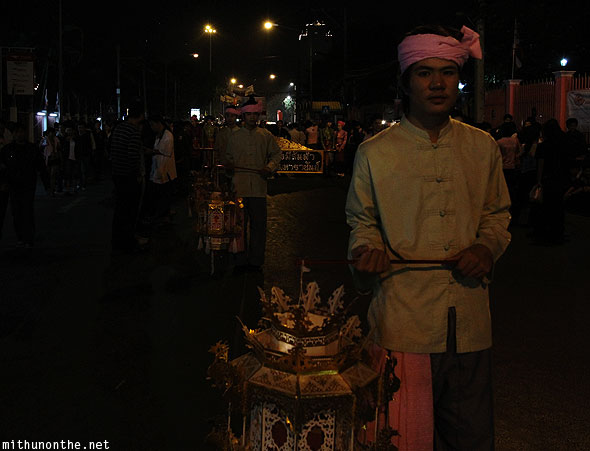 Thai man Loy Krathong parade holding lamps