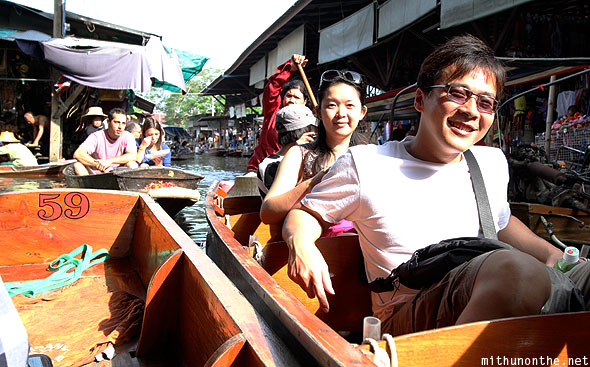 Asian tourists floating market Thailand