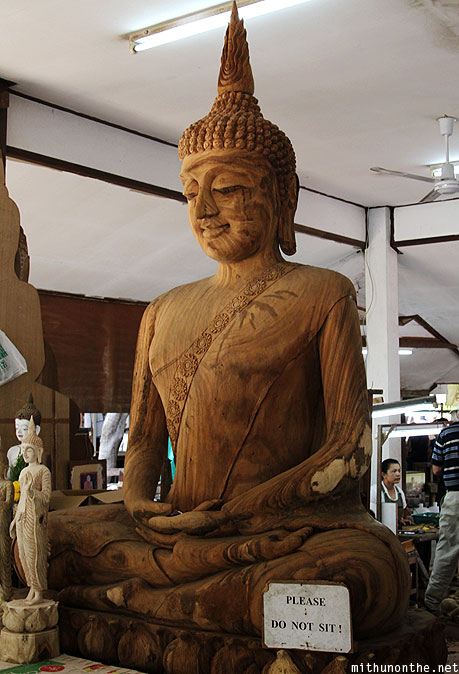 Buddha statue wood carving Thailand