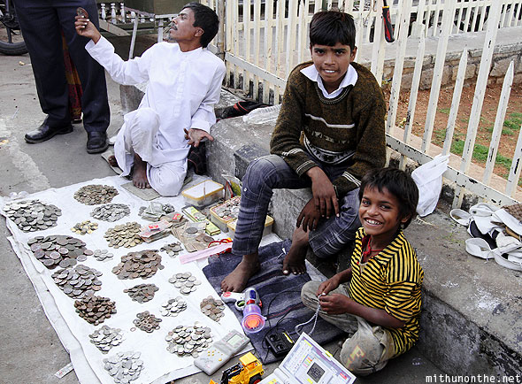 Charminar fort street kids old coins Hyderabad India
