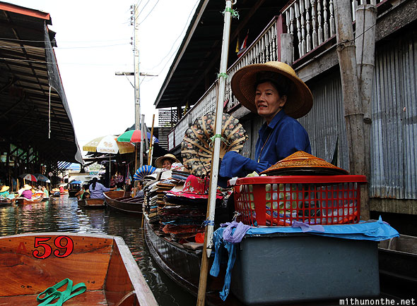 Damnoen Saduak floating market hats vendor Thailand