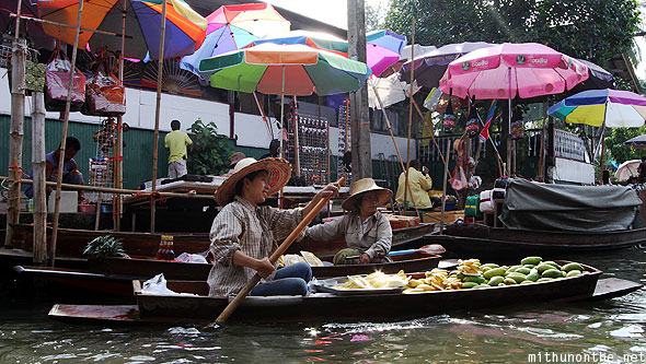 Damnoen Saduak floating market boats fruit hawker Ratchaburi Thailand
