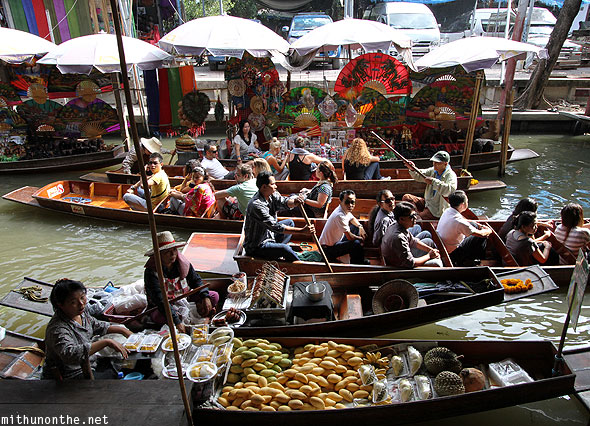 Damnoensaduak floating market boats crossing Ratchaburi Thailand