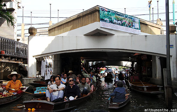 Damnoen Saduak floating market under bridge Thailand