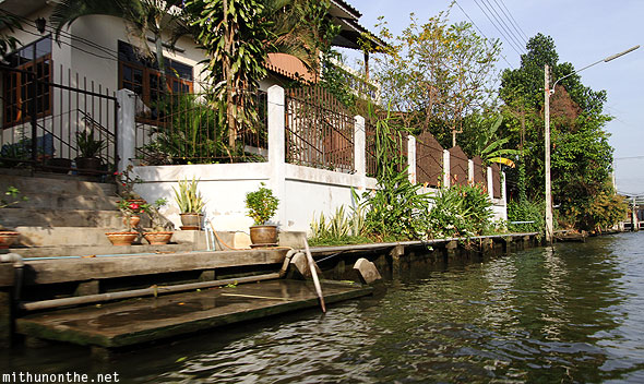 Damnoen Saduak floating village house by river Bangkok Thailand