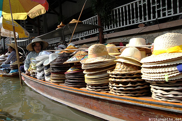 Damnoensanduak floating market hats hawker Thailand