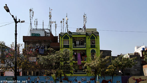 Hyderabad colourful houses dish antennas cartoon wall