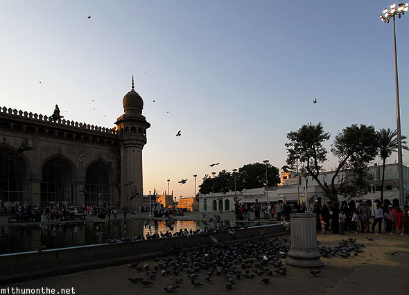 Mecca Masjid sunset pigeon feeding Hyderabad India