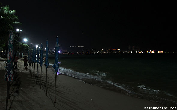 Pattaya Bay beach at night umbrellas