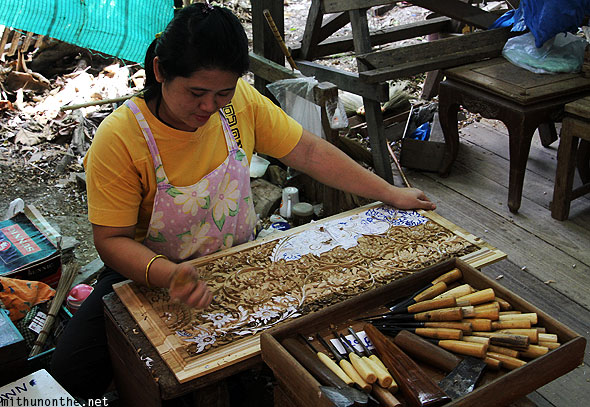 Thai craftswoman handicraft carving Thailand