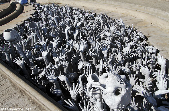Wat Rong Khun white temple skull hell hands dead