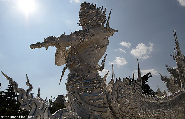 White temple Wat Rong Khun warrior sculpture Chiang Rai Thailand