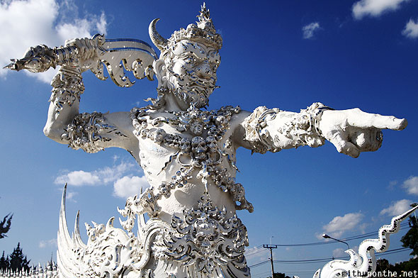 White temple Wat Rong Khun warrior sculpture Chiang Rai