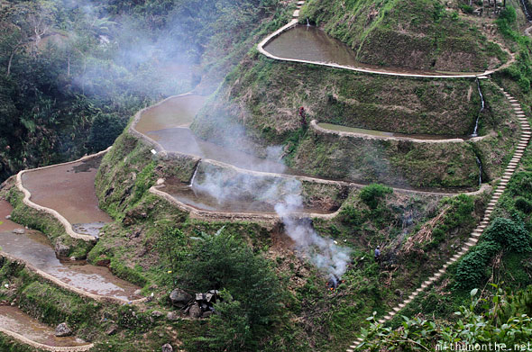Banaue rice terrace steps burning smoke