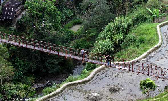 Banaue town narrow bridge tourists Philippines